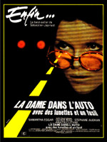 la-dame-dans-lauto-avec-des-lunettes-et-un-fusil-1970
